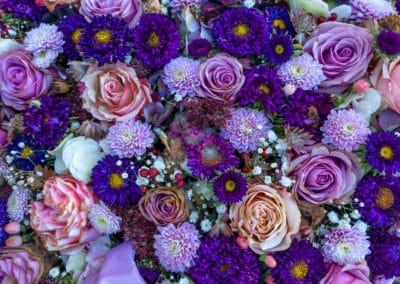 Slightly withered purple flower arrangement