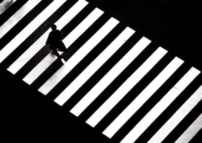 A man crossing zebra crossing in Japan