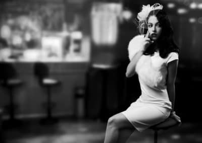 Retro Style Image. Smoking Lady In The Bar