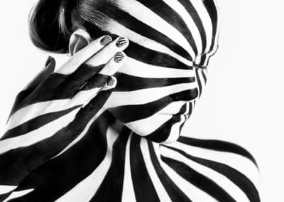 Spiral bodyart on the body of a young girl