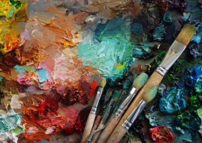 Vintage stylized photo of paintbrushes closeup and artist palett