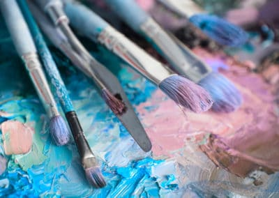 macro artist's palette, texture mixed oil paints in different co